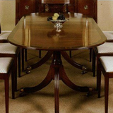 T.5 A Mahogany twin pedestal Table 72 inches x 40 inches extending to 90 inches x 40 inches. Placing's for 8.