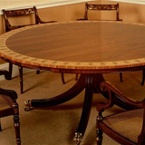 T.73 A Rosewood Circular Table with a double cross-banding of Satinwood and Tulipwood with a decorative hand-painted border in a 'Honeysuckle' design. 66 inch in diameter 29.5 inch H.