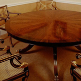 T.82S 72 inch diameter Platform-base Table, shown with a 'Sunburst' top of 16 curl Mahogany segments and cross-banded border in Rosewood. Placing's for 10. Available in plain Mahogany, Yew or Rosewood.